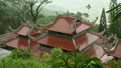 Wide shot of top of Vietnam Takou Linh Son Truong Tho pagoda Stock Footage