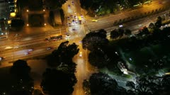 Time-lapse high view of a busy road junction at night in Singapore Stock Footage