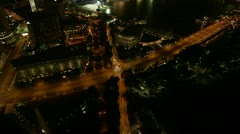 Birds eye time-lapse view of busy cross roads at night in Singapore. - stock footage