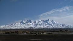 Pan across mountains, Mt Ruapehu to Mt Ngaruhoe Stock Footage