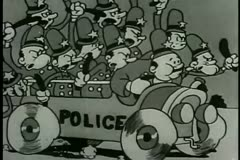 Wide shot policemen in car waving billy clubs - stock footage