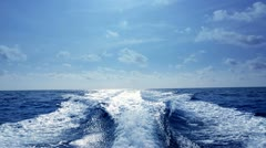 blue ocean sea with fast yacht boat wake foam - stock footage