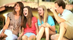 Young Family Talking Together Front garden Stock Footage