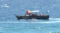 Tourist boat and people on the beach of Giardini Naxos. Stock Footage