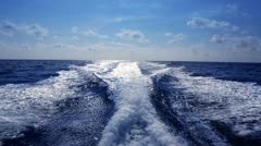 Stock Video Footage of blue ocean sea with fast yacht boat wake foam