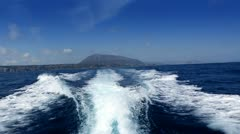 Boating in blue ocean sea view from boat in ibiza Stock Footage