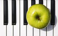 Stock Photo of apple on piano