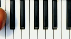 Apple on piano three Stock Footage