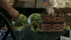 Stock Footage - Man filling country basket with produce at market Stock Footage