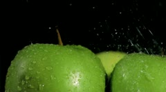 Green apples being watered in super slow motion Stock Footage