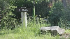 Trail path sign in the woods Stock Footage