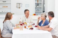 Mature friends taking lunch together Stock Photos