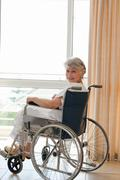 Woman in her wheelchair looking at the camera Stock Photos