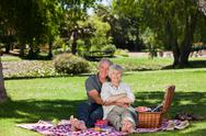 Stock Photo of Elderly couple picnicking in the garden