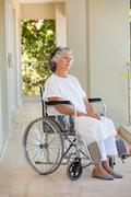 Woman in her wheelchair - stock photo