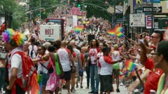 2012 New York Pride Parade crowd stretches down 5th Ave, Long Lens Stock Footage