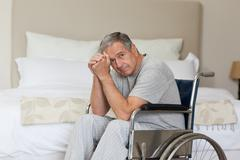Thoughtful senior man in his wheelchair Stock Photos