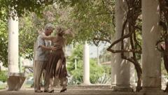 Happy senior couple dancing latin american dance for fun Stock Footage