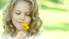 Closeup portrait of a girl with yellow flower - stock footage