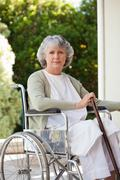 Senior woman in her wheelchair - stock photo