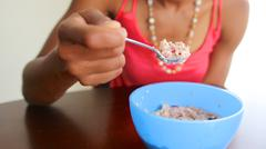 African american woman eating oatmeal Stock Photos