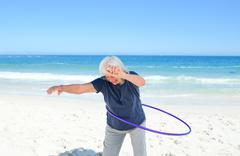 Senior woman playing with her hoop Stock Photos