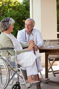 Senior doctor talking with his mature patient Stock Photos