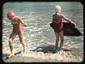 Stock Video Footage of 1939 Vacation Beach Girls Surf Swim Fun - Vintage 16mm Film
