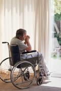 Senior man in his wheelchair Stock Photos