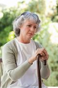 Retired woman with her walking stick Stock Photos