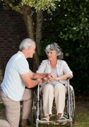 Mature couple in the garden Stock Photos