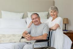 Mature couple in their bedroom Stock Photos