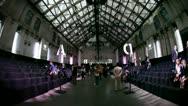 Spectators enter Zuiveringshal West catwalk fashion hall timelapse Stock Footage