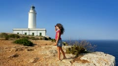 Beautiful little girl greeting in mediterranean lighthouse Stock Footage