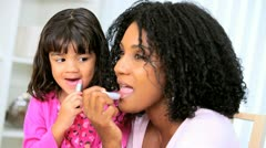 Pretty Ethnic Mom Daughter Using Cosmetics - stock footage