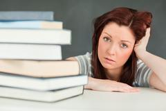 Hopeless student in a classroom - stock photo