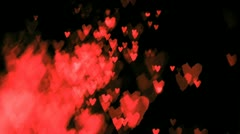 Hearts sparkles blown in super slow motion - stock footage