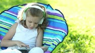 Child playing with the headphones Tablet PC Stock Footage
