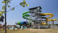 People enjoying on water slide at aqua park Stock Footage