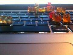 Gummi Bears on mac laptop - stock photo
