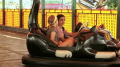 Vancouver bc canada -  july 9 2012 young girls driving bumper cars at playlan Stock Footage