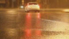 Torrential rain in a desert city - car waiting to cross traffic in intense rain Stock Footage