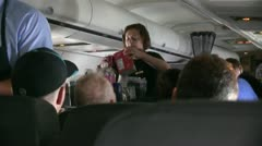Airliner stewardess, steward, juice Stock Footage