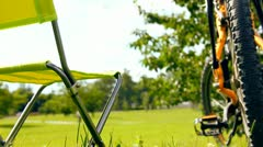 Camping in sunny park after bicycle tour Stock Footage