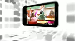 Videos of a primary classroom on a smartphone screen - stock footage
