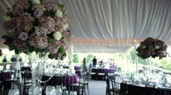 Stock Video Footage of wedding table setting under tent with photo shoot