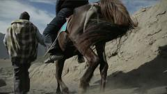 People and horse rides through the mountains in Indonesia Stock Footage