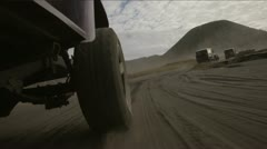 Jeep ride across the steppe near the mountains of Indonesia - stock footage
