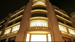 Louis Vuitton Store in Paris at night - stock footage