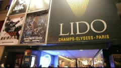 Camera tilt to the entrance of the LIDO in paris Stock Footage
